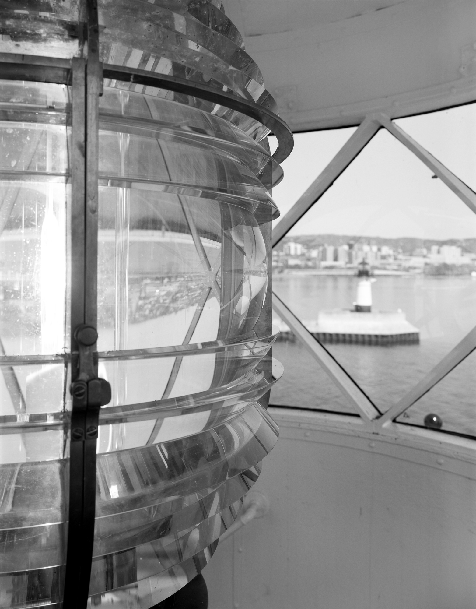 South Breakwater Light Fresnel Lens (North Pier Light in background) - SL-DUL-2003-10 (Please credit Daniel R. Pratt and the Minnesota Historic Property Record)