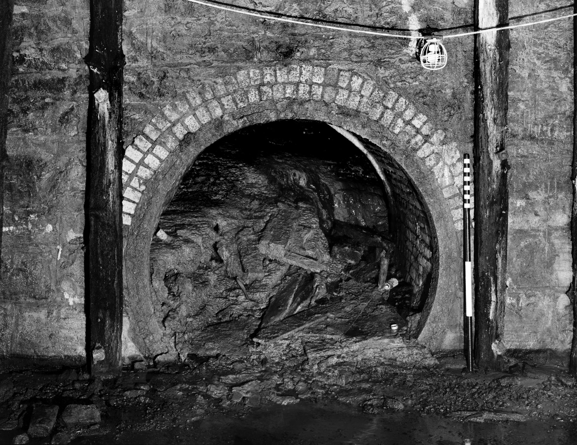 Tunnel to Phoenix Mill in headrace wall - MHRP HE-MPC-9995-06 (Please credit Daniel R. Pratt and the Minnesota Historic Property Record)